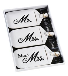"""These 3 white leatherette luggage tags offer a fun way to identify your luggage for the honeymoon. Each measures 2.5"""" x 5"""". Black embroidery is used to identify the tags as """"Mr.,"""" """"Mrs."""" and """"More Mrs"""