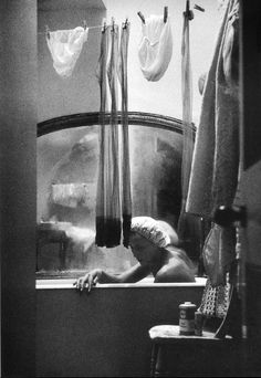 A girl who shares a bath and flat with three other girls, London, 1961 by Eve Arnold