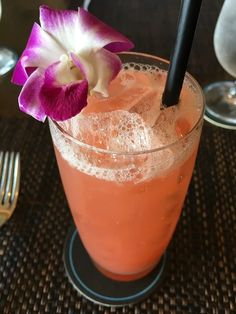 Pretty in pink, the #Waiolu 'Polynesian Paradise' delights with Guava, Hibiscus, Fresh Lime, and Ginger Ale. #TrumpWaikiki #Waikiki #Hawaii #Tropical #Drink #Mocktail #Guava #Vacation #Paradise