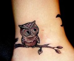 owl on ankle. I am not into owls, but he is just too cute to pass up.