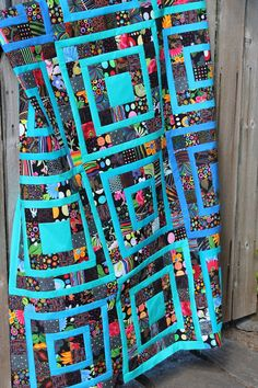 Scrap quilt, with tutorial, at Quilting is more fun than Housework
