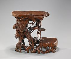 "Description: Unusual Chinese Naturalistic Rootwood Stand Unusual Chinese naturalistic rootwood stand; of openwork, somewhat tree form, with three flat areas for displaying objects; L: 10 1/2"" (overall)"