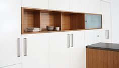 Among the white cabinetry, wooden cabinet insets like these, but in singles and doubles, and without the glass cover.