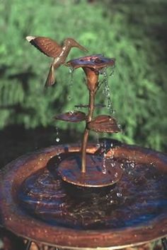 Attract more birds with moving water in your bird bath! Copper Hummingbird Fountain graces your birdbath with whimsy and charm, moving water entices more birds