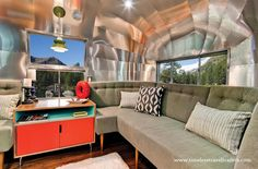 This 1962 40' Airstream trailer was originally owned by Western Pacific Railroad Company.  Timeless Travel Trailers custom-designed the interiors and transformed it into a luxurious living space.