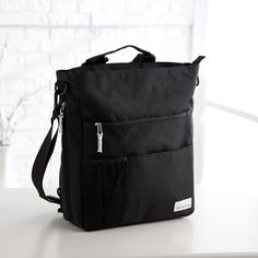 Have to have it. Amy Michelle Lexington Go Work Tote - Black - $69.95 @hayneedle  polyester with antimicrobial lining, 5 pockets, adjustable strap that can convert to backpack #12Lx4-6Wx14H inches. #messengerbag #worktote This messenger bag is full of features like a zippered front section, a cell phone pocket, slip pocket in back and two internal and one external water bottle pocket  easy to clean#wantit #wishlist #backtoschoolshopping #college other totes available.