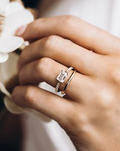 The Gardenia setting paired with the Super Skinny Daylight Band is a perfect pair. This image features a 1 carat emerald cut center stone with four claw prongs set east-west in a 2mm 14k yellow gold shank. The shank has 12 round brilliant diamonds to add that extra sparkle factor.