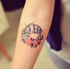 Circular floral tattoo by Grain