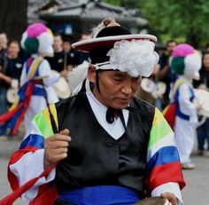 The band leader of a group of traditional Korean drummers, who performed on the street in the historic old town area of the city of Jeonju.