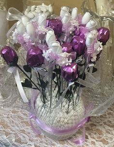 Amazing bouquet of chocolate roses AND Jordan almonds artistically arranged in a bouquet to make an attractive table center piece. Each guest can then pick a favor of 1 rose chocolate and 1 almond holder. Available in any count and in multiple colors.