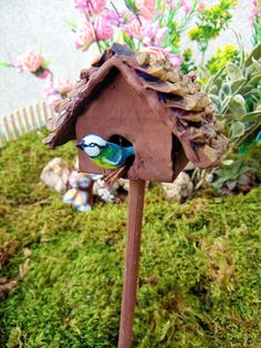 Pinecone roof fairy bird dove house, Bird House, fairy house, birdhouse, fairy accessories,mini fairy house, fairy garden decor, fairy flowers      Hi! This listing is for what you see on the picture! Handmade beautiful bird house, with roof, made of pinecones! There is flowers on the stick and a white dove bird is perched on the stick!    This sweet birdhouse will add a magic touch to your sweet fairy garden! :)  You even can put this seet house in your flower pot! :)    Add to it- Handmade…