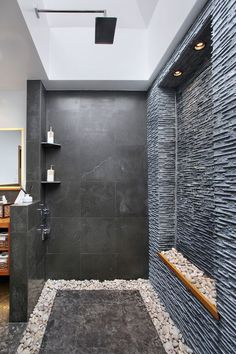 black stone and pebbles all around for a cool spa like look