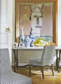 Always like using big art over furniture, the marble & iron table goes well with it and the striped chairs too. (chic apartment in Paris' Saint-Germain-des-Prés district. Apartment Chic, Apartment Design, White Apartment, Home Staging, Interior Inspiration, Design Inspiration, Striped Chair, Decoration Bedroom, Chinoiserie Chic