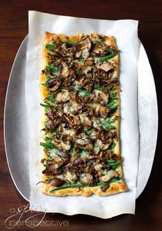 This savory tart kicks old green bean casserole to the curb! Green Bean Mushroom Tart, loaded with fresh green beans, sauteed crimini mushrooms, crispy shallots, and blue cheese will be the talk of the table this Thanksgiving! Green Bean Recipes, Veggie Recipes, Tart Recipes, Vegetarian Recipes, Cooking Recipes, Healthy Recipes, Mushroom Tart, Vegetarian Thanksgiving, Thanksgiving Table