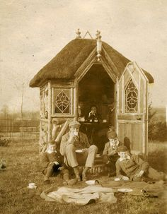 This Edwardian thatched summerhouse seems a little isolated in its landscape but clearly the family of Henry Hammond are enjoying their tea.