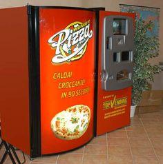 whole pizza vending machine - https://johnrieber.com/2013/03/17/body-parts-whiskey-burgers-crazy-classic-vending-machines/