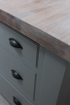 Solid oak wood worktops finished with liming wax and an eco friendly oil. Give a nice light finish.