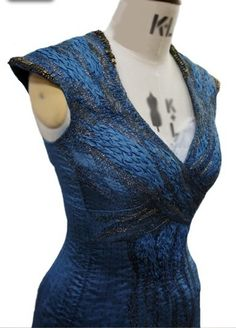 Daenerys Targaryen`s blue tunic from Season 3 of `Game of Thrones`. Design by Michele Clapton, with dragon scale-inspired embroidery by Michele Carragher.