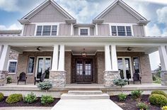 Traditional Exterior of Home with exterior stone floors, Pathway, exterior brick floors, Wrap around porch Traditional Home Exteriors, Traditional House, Traditional Ideas, Building A Porch, Building A House, Building Ideas, Exterior Tradicional, Stucco Homes, Brick Homes