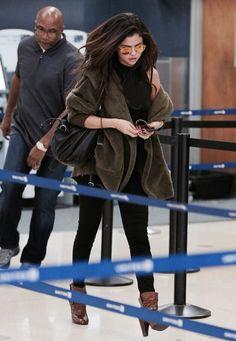 Selena Gomez arrives at LAX airport - 2014