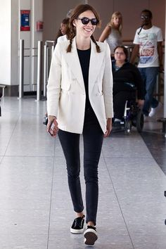 thefashioncomplex: Alexa Chung at Heathrow Airport on May 19,...