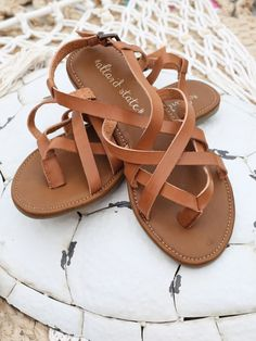 These simple and fun sandals are the perfect staple for your summer wardrobe!  Altar'd State Strappy Toe Sandals - Footwear