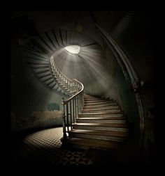 The shaft of light down an old decrepit spiral staircase  (from Two Pins, Spirals Group Board)