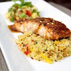 Spice crusted baked salmon topped with a sweet soy glaze and a side of avocado relish.