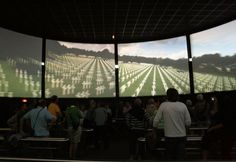 Arromanches 360 theater--those are movie screens; not windows and as you watch, they change from what that scene looked like during the D-Day era of WWII and then it would fade into what it looks like at the same spot today.  On one screen, a tractor was plowing in a beautiful field with birds flying and singing--then it faded to a horrible war scene. Very effective.