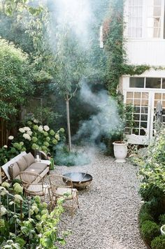 Love the pebbled garden and rustic but comfortable outdoor furniture