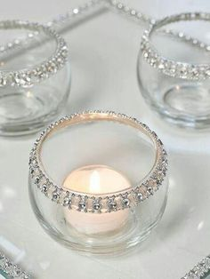 Use use hot glue to add rhinestones to inexpensive candle holders from dollar store or craft stores