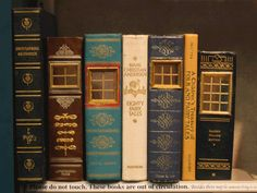 """Saw this pic of """"urban fairy houses made out of book spines"""" and upon closer look, saw that this is OUR yellow fairy tale book! (diff cover, but Eric Protter is our guy!)!  :-D"""
