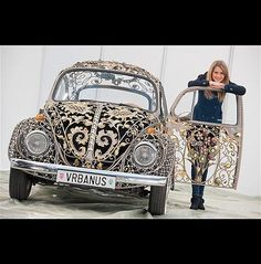 Wrought Iron Volkswagen Artistic Beetle (© Essen Motor Show). It'€™s a classic 1970 VW Beetle that'€™s had all of its bodywork replaced with wrought iron by a Croatian metal-working firm as a publicity stunt. That'€™s real 24-karat gold leaf, too.