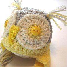 Newborn crochet yellow and grey owl hat.