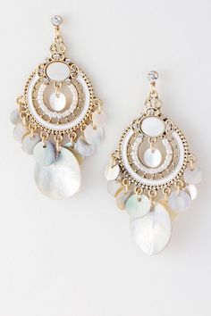 Pearlescent shimmer of Mother of Pearl set in a beautiful Boho style accented with antiqued Filigree details, hand painted enamel and delicate seed beads.