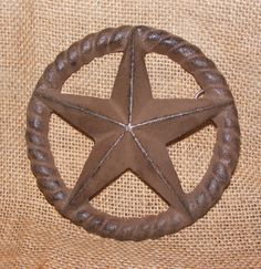 """Cast Iron Star Rope Plaque Craft Garden Country Rustic Decor Primitive #309•Great for a rustic or western-themed home or garden project! •Very sturdy cast iron with rusty brown finish and nice detail •Measures 5"""" across •There is a hook at the back for easy mounting- no hardware included •Free Shipping!"""