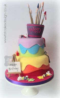 Artists cake. For a painter. Rainbow paint cake with brushes and easel.