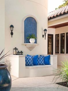 Classically Spanish Gorgeous outdoor patio with blue tile accents and pillows, in our unique Hacienda Chic style