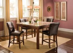 Like these chairs!    Give your dining room or kitchen a striking centerpiece with this Samuel 5-piece counter-height dining set. Carefully crafted of durable mahogany, pine and Asian hardwoods, this dining set will warm your space with its beautiful mahogany finish. Its luxurious marble tabletop and espresso leather-look chair seats with elegant button tufting complete its unique look.