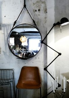 leather wrapped mirror and jielde lamp  from 47ParkAv