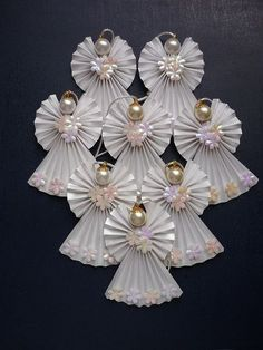 origami angels - decorate both sides so it's pretty from any angle. could use a wire headpin to more firmly secure bead to angel and even use end extending upward to secure the halo