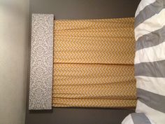 My box cornice and chevron curtains to match my grey and yellow bedroom! :)