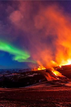 Wonders of Nature. Aurora Borealis over Volcano, Iceland