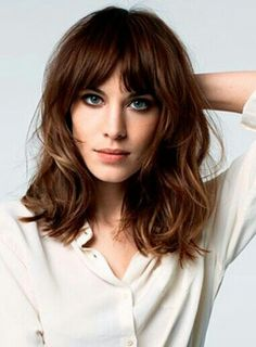 Alexa Chung's signature hair with bangs