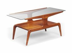 A Gio Ponti walnut and glass occasional table, 1950s.