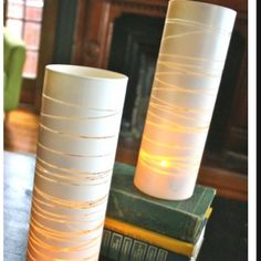 Candle holders. All you need is a clear vase, rubber bands, and spray paint!