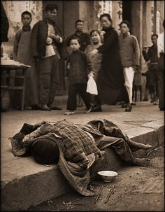 Vintage Photographs of Pre-Revolution China, 1870-1946 - During The Famine Young Child Dying In The Gutter, China [1946] Geroge Silk