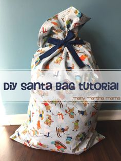 DIY Santa Bag Tutorial- This step by step tutorial will tell you how to make a santa sack to put your Christmas presents in. Diy Christmas Sacks, Christmas Sewing, Christmas Bags, Diy Christmas Ornaments, Diy Christmas Gifts, Handmade Christmas, Christmas Ideas, Christmas Decorations, Christmas Things