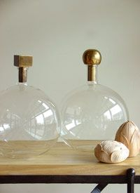 "(These are juuuust enough of ""steampunk lab equipment"" to make my everyday heart happy.) decanters // brass stoppers"