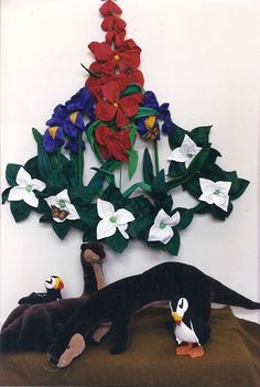 Labrador Life (1996, soft sculpture): wildflowers, otters, and puffins by Shirley Frey McConahay